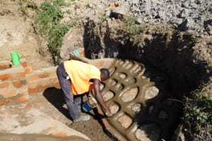 The Water Project: Shihingo Community, Mangweli Spring -  Finishing The Stone Wall