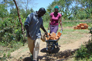 The Water Project: Malava Community, Ndevera Spring -  Bringing Bricks Down To The Construction Site
