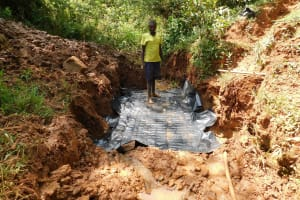 The Water Project: Mutao Community, Shimenga Spring -  Building The Foundation