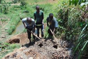 The Water Project: Musango Community, Mushikhulu Spring -  Mixing Cement