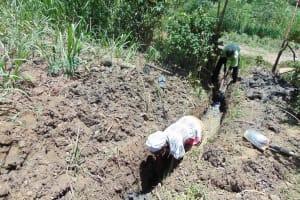 The Water Project: Mukhuyu Community, Kwakhalakayi Spring -  Digging Drainage