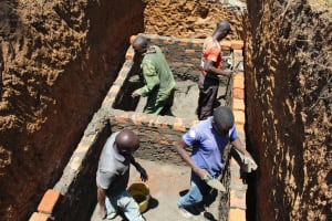 The Water Project: Mayoni Township Primary School -  Lining The Latrine Pit