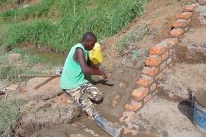 The Water Project: Musango Community, Mushikhulu Spring -  Pitching Stones