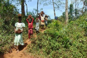 The Water Project: Sichinji Community, Makhatse Spring -  Carrying Bricks Down To The Spring