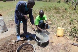 The Water Project: Mukhuyu Community, Kwakhalakayi Spring -  Mixing Cement