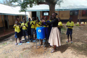 The Water Project: Ibwali Primary School -  Trainer Leads Handwashing Activity