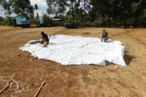 The Water Project: Immaculate Heart Secondary School -  Weaving A Layer Of The Dome