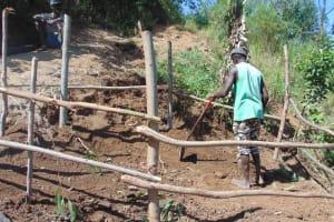 The Water Project: Musango Community, Mushikhulu Spring -  Finishing The Fence