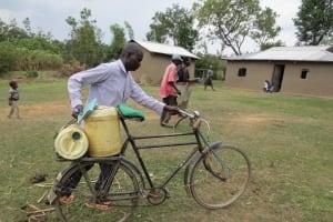 The Water Project: Mukhuyu Community, Kwawanzala Spring -  Man Transporting Water