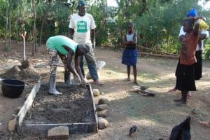 The Water Project: Musango Community, Mushikhulu Spring -  Sanitation Platform Construction