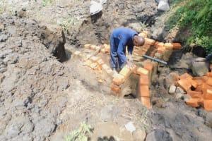 The Water Project: Munenga Community, Burudi Spring -  Brick Laying