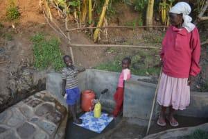 The Water Project: Munenga Community, Burudi Spring -  Grandmother Watching Grandchildren