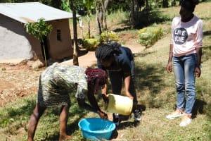 The Water Project: Shihingo Community, Mangweli Spring -  Handwashing Teamwork