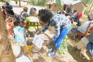 The Water Project: Munenga Community, Burudi Spring -  Traininig Materials Helped Drive The Point Home