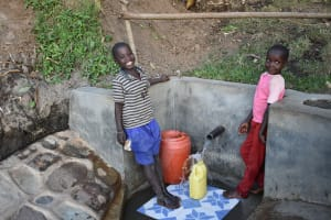 The Water Project: Munenga Community, Burudi Spring -  Drawing Water