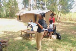The Water Project: Munenga Community, Burudi Spring -  Trainer Betty In Action