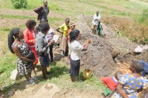 The Water Project: Munenga Community, Burudi Spring -  Trainer Lynnah Leads Handwashing Activity