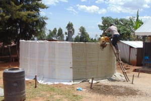 The Water Project: Musasa Secondary School -  Adding Cement