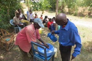 The Water Project: Mukhuyu Community, Kwawanzala Spring -  Handwashing Training
