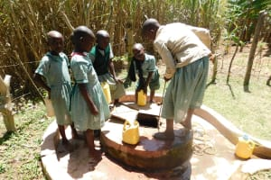 The Water Project: Mukangu Primary School -  Fetching Water