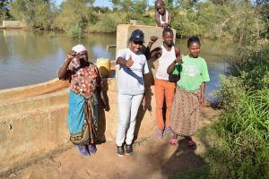 The Water Project: Katung'uli Community B -  Anna Wabamba Field Officer Lilian Kendi Solomon Kyalo Elizabeth Nduku And Timothy Musau