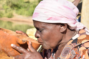 The Water Project: Katung'uli Community B -  Drinking Water From The Well