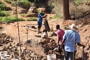 The Water Project: Ivumbu Community -  Working On Dam