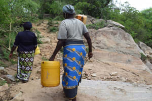 The Water Project: Kaketi Community -  Carrying Water