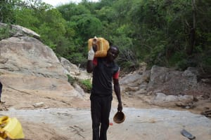The Water Project: Kaketi Community A -  Carrying Water