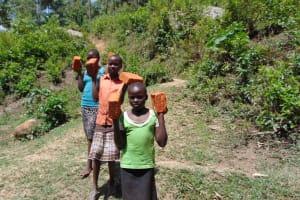 The Water Project: Eshiasuli Community, Eshiasuli Spring -  Students Bring Bricks