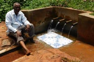 The Water Project: Shilakaya Community, Shanamwevo Spring -  John Sits For His Interview