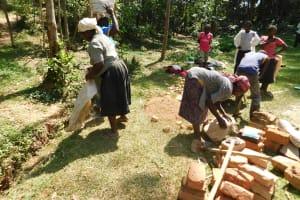 The Water Project: Wajumba Community, Wajumba Spring -  Community Members Helping