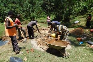 The Water Project: Wajumba Community, Wajumba Spring -  Mixing Cement