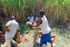 The Water Project: Burachu B Community, Namukhuvichi Spring -  Passing Along Bricks