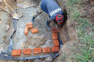 The Water Project: Burachu B Community, Namukhuvichi Spring -  Building The Wall