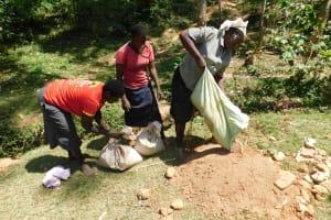 The Water Project: Wajumba Community, Wajumba Spring -  Delivering Sand
