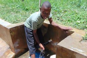 The Water Project: Elukuto Community, Isa Spring -  Karim Tohola