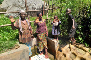 The Water Project: Ngeny Barak Community, Ngeny Barak Spring -  Still Happy With Flowing Water In July