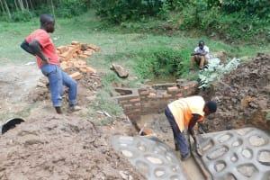 The Water Project: Wajumba Community, Wajumba Spring -  Stone Pitching