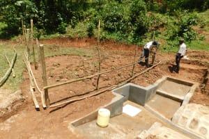 The Water Project: Wajumba Community, Wajumba Spring -  Buliding The Fence