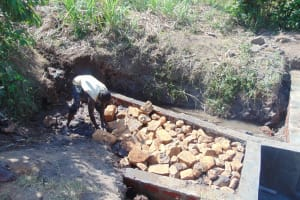 The Water Project: Musango Community, Emufutu Spring -  Back Filling