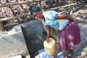 The Water Project: Eshiasuli Community, Eshiasuli Spring -  Fetching Water