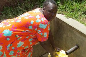 The Water Project: Futsi Fuvili Community, Simeon Shimaka Spring -  Jacklyne Fetches Water