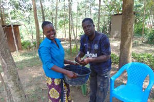 The Water Project: Musango Community, Emufutu Spring -  A Man Demonstrating How He Washes His Hands