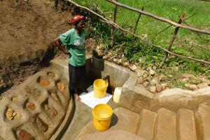 The Water Project: Sambuli Community, Nechesa Spring -  Fetching Water