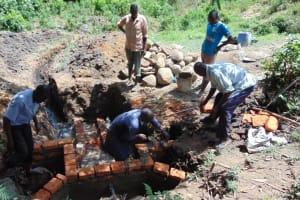 The Water Project: Eshiasuli Community, Eshiasuli Spring -  Teamwork