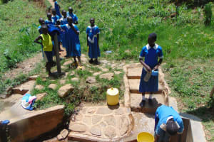 The Water Project: Ivulugulu Community, Ishangwela Spring -  Fetching Water