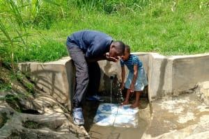 The Water Project: Musango Community, Dawi Spring -  Taking A Drink