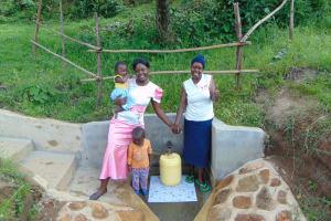 The Water Project: Mukoko Community, Mukoko Spring -  Fetching Water