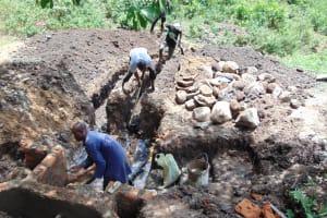 The Water Project: Eshiasuli Community, Eshiasuli Spring -  Digging Diversion Channel